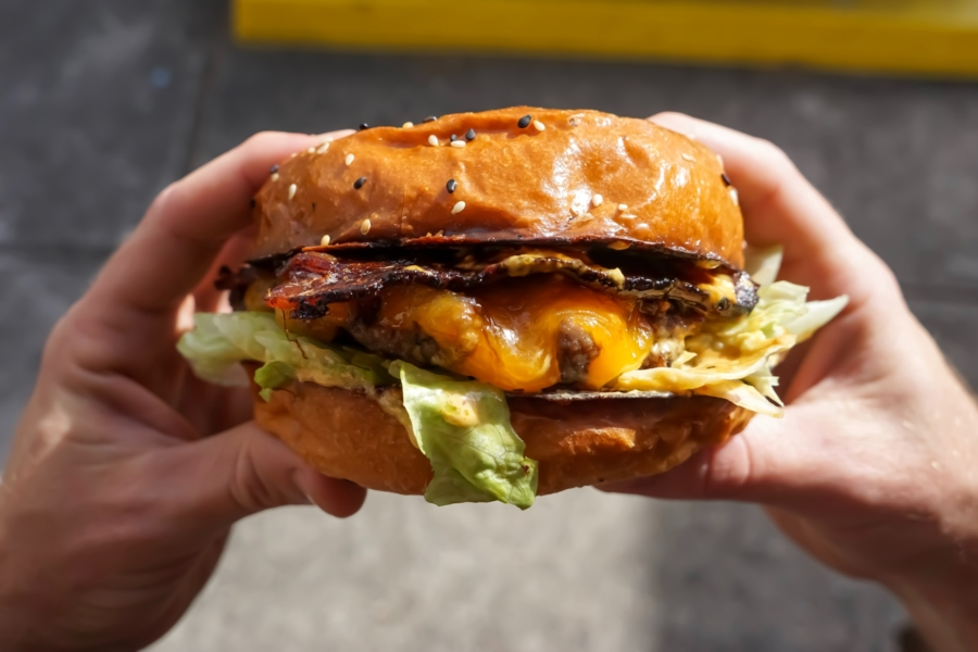 Regularly eating foods like this delicious cheese burger is an unhealthy disease-inducing habit.