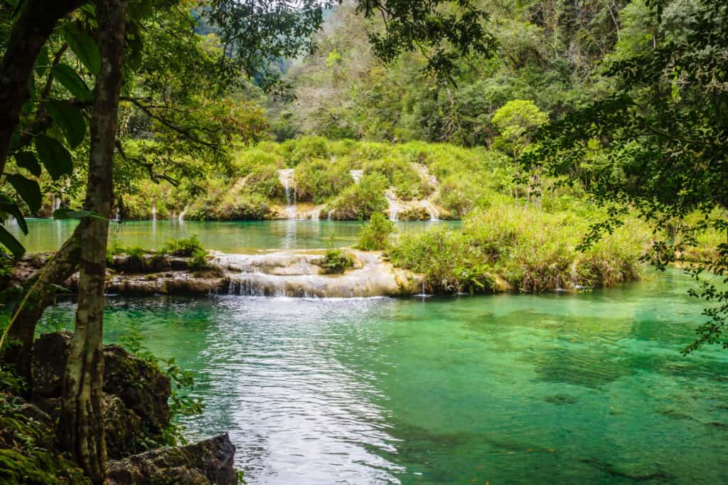 Waterfall in a lush tropical setting.