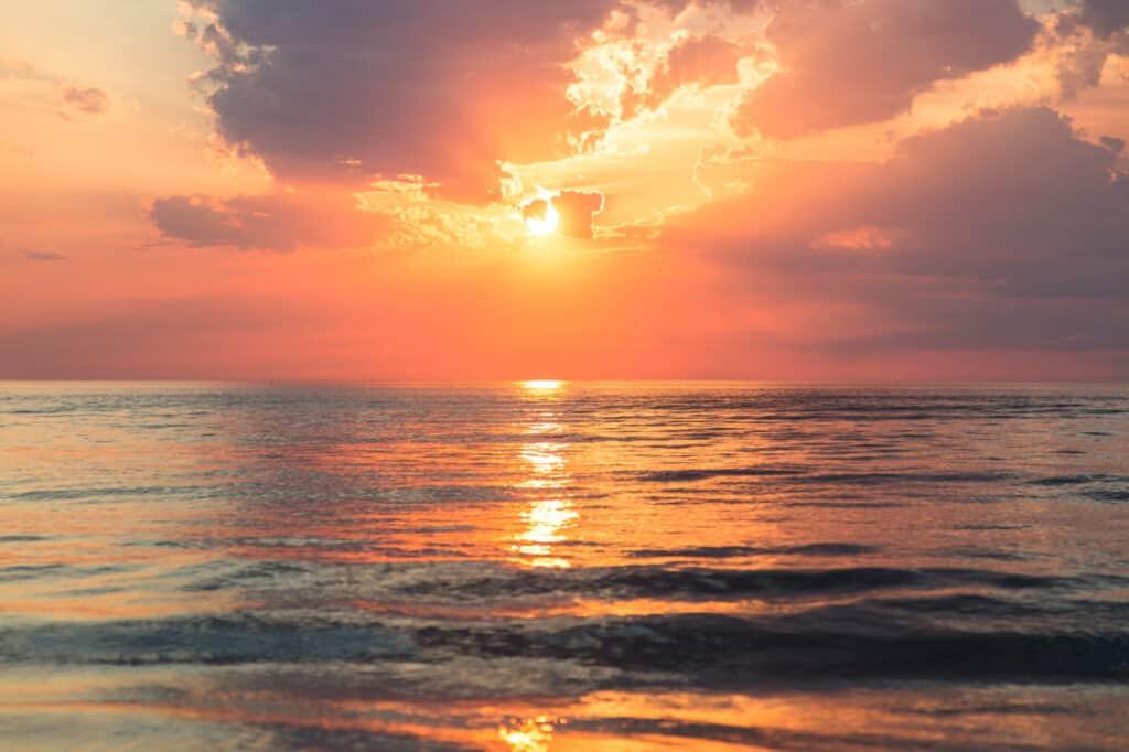 Sunset over a calm ocean.