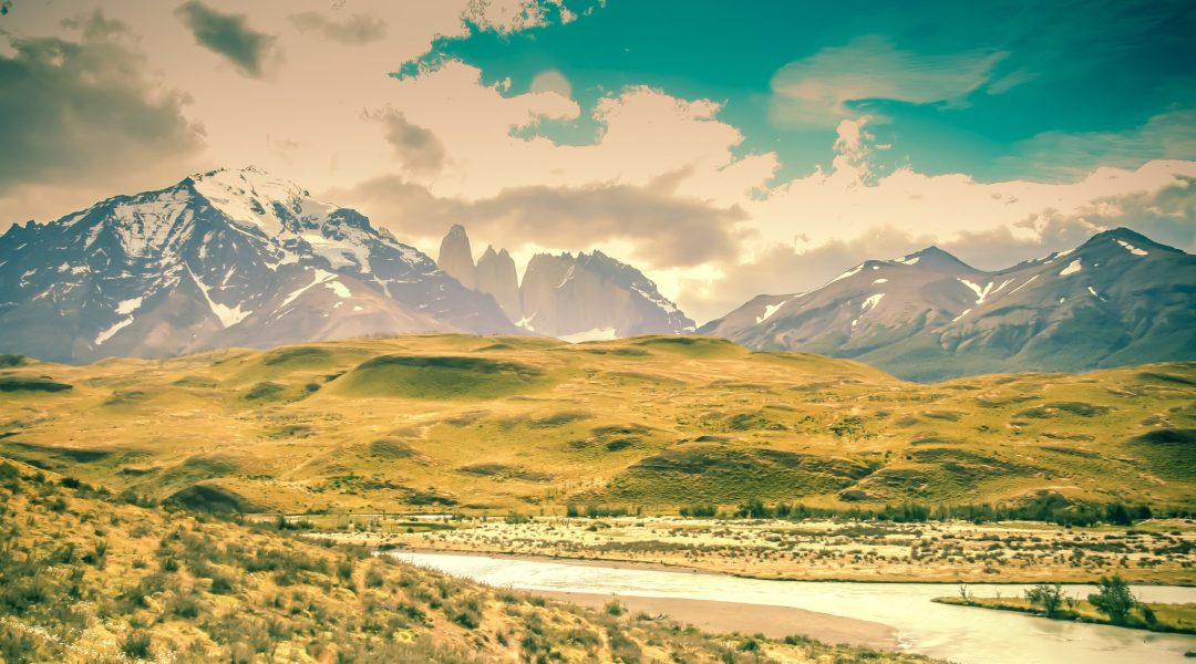 Beautiful landscape picture of mountains, hills and a stream.